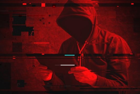 hacker with tablet operation shadow web