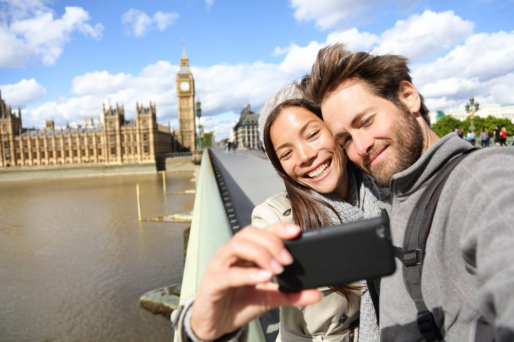 couple taking selfie with smartphone