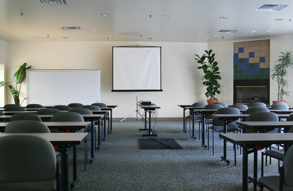 empty conference room with projector and screen