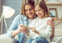 mum and daughter using smartphone